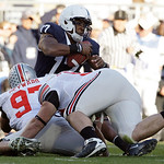 Ohio State's Cameron Heyward (97) andTodd Denlinger (92) sack Penn State quarterback Daryll Clark (17) during the first half of an NCAA college football game in State College, Pa., Saturday, …