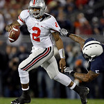 Ohio State quarterback Terrelle Pryor (2) scrambles out of the pocket away from Penn State defender Jerome Hayes (5) during the second half of an NCAA college football game in State College, …
