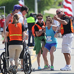 The heat and the effort are too much for Erin Schaefer who collapses and needs aid within site of the finish line of the Cleveland Rite Aid Marathon. photo by Ray Riedel