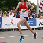 Marty Coolidge of Elyria, OSHAA record holder and former EC runner, crosses the finish line of the 10K race in Cleveland at the Rite Aid Marathon. photo by Ray Riedel