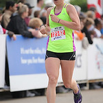 Kelly Staruch, former runner for Medina Highlands, crosses the finish line for the Half-Marathon race at the Cleveland Rite Aid Marathon. photo by Ray Riedel