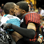Gladiators' defensive back Joe Phinisee hugs Arizona Rattlers' wide receiver Kerry Reed after the Gladiators lost. KRISTIN BAUER | CHRONICLE