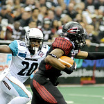 Gladiators' wide receiver Thyron Lewis is brought down by Arizona Rattlers' defense back Jeremy Kellem. KRISTIN BAUER | CHRONICLE