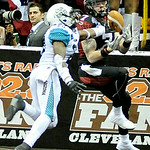 Gladiators' wide receiver Tom Gilson struggles to catch a pass while defended by Arizona Rattlers' defensive back Jeremy Kellem. KRISTIN BAUER | CHRONICLE