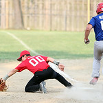South Amherst Crushers first base Colin Ransom gets the out before Columbia Morgan Truckers Chris Bowes can run down the base.  ANNA NORRIS/CHRONICLE