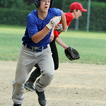 Columbia Morgan Truckers' Andy Perrott steals home on a South Amherst Crushers error. ANNA NORRIS/CHRONICLE