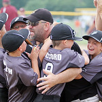 Vermilion Impact players hug their coach after winning the Hot Stove Class H regional championship over Wellington Rampage yesterday at Reservoir Park in Grafton. (CT photo by Anna Norris.)