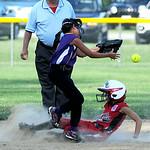 Elyria Little League's Jessica Chapman slides safely into second base past Avon Little League's Malina Rivera.  KRISTIN BAUER | CHRONICLE