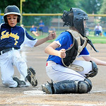 Tallmadge Little League's Zander Boyd beats the tag from Elyria East Little League catcher Clayton Peloquin at home plate. KRISTIN BAUER | CHRONICLE