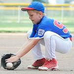 Elyria East Little League relief pitcher Jordan Lamb fields a ball. KRISTIN BAUER | CHRONICLE