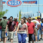 NHRA fans walk through Nitro Alley at Norwalk on July 4. STEVE MANHEIM/CHRONICLE