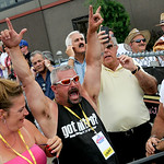 Fans react to the power of 300mph top fuel dragsters taking off at the Summit NHRA Racing Equipment Nationals on July 5.  KRISTIN BAUER | CHRONICLE