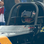 Luigi Novelli, 71, sits in a cloud of smoke from his top fuel dragster on July 5.  KRISTIN BAUER | CHRONICLE