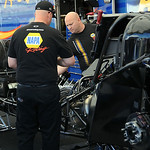 The NAPA racing team works on car at the NHRA qualifying race on July 4. STEVE MANHEIM/CHRONICLE