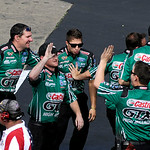 John Force's Castrol GTX crew cheers after Force won the Funny Car finals heat on July 6. KRISTIN BAUER | CHRONICLE