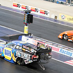 Allen Johnson (left) and Mike Edwards race down the track in the final round of the Pro Stockclass in the 2013 Summit Racing Equipment NHRA Nationals yesterday at Summit Motorsports Park in  …