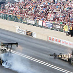 Doug Kalitta (left) and Khalid Albalooshi (right) race in the final round of the Top Fuel class in the 2013 Summit Racing Equipment NHRA Nationals yesterday at Summit Motorsports Park in Nor …
