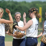 The Sun Dogs 14U team high fives before the start of a game against the Ohio Storm softball team, from Mt. Vernon, on Saturday. KRISTIN BAUER | CHRONICLE