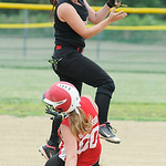 Firelands' Hailey Blankenship slides safely into second under the tag from Crushers' short stop Kirsten Lara. KRISTIN BAUER | CHRONICLE