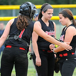 Teammates cheers on Crushers' pitcher Selena Shawver during a tough inning against Firelands. KRISTIN BAUER | CHRONICLE
