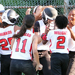 The Lorain Dirt Devils clear the dugout to celebrate Julia Velez's home run in the top of the fourth inning, where the Dirt Devils scored 10 runs, against Firelands yesterday at Palmer Field …