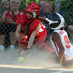 Lorain Dirt Devils' Talia Harris slides safe into home before Firelands catcher Victoria Jackson can make the tag in the top of the fourth inning yesterday at Palmer Field in North Rigdevill …