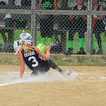 Ashley Krupinski, of the Colombia Red Wagon, slid into home plate. She and her team went on to win that match 11-1.