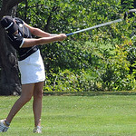 Nikki Sherman of Medina takes a shot on the green. STEVE MANHEIM/CHRONICLE