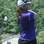 Annika Neuman of Avon tees off. STEVE MANHEIM/CHRONICLE