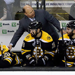 Boston Bruins head coach Claude Julien instructs Daniel Paille (20), Kaspars Daugavins (16), of Latavia, and Patrice Bergeron (37) during the third period in Game 3 of the NHL hockey Stanley …