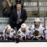 Chicago Blackhawks head coach Joel Quenneville shouts instructions to his team during the third period in Game 3 of the NHL hockey Stanley Cup Finals against the Boston Bruins in Boston, Mon …