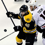 Boston Bruins center Rich Peverley (49) and Chicago Blackhawks center Jonathan Toews (19) fight for the loose puck during the first period in Game 3 of the NHL hockey Stanley Cup Finals in B …