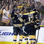 Boston Bruins center Patrice Bergeron, left, celebrates his goal against the Chicago Blackhawks with Milan Lucic (17) and Tyler Seguin (19) during the second period in Game 3 of the NHL hock …