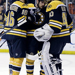 Boston Bruins left wing Kaspars Daugavins (16), of Latavia, and defenseman Andrew Ference, center, congratulate Boston Bruins goalie Tuukka Rask (40), of Finland, after his shutout against t …