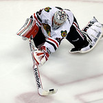 Chicago Blackhawks goalie Corey Crawford clears the puck against the Boston Bruins during the first period in Game 3 of the NHL hockey Stanley Cup Finals in Boston, Monday, June 17, 2013. (A …