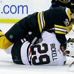 Boston Bruins defenseman Zdeno Chara (33), of Slovakia, takes down Chicago Blackhawks left wing Bryan Bickell (29) during the third period in Game 3 of the NHL hockey Stanley Cup Finals in B …