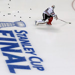 Chicago Blackhawks goalie Corey Crawford skates during warm-ups before Game 3 of the NHL hockey Stanley Cup Finals against the Boston Bruins in Boston, Monday, June 17, 2013. (AP Photo/Charl …