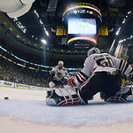 Chicago Blackhawks goalie Corey Crawford (50) kicks the puck away as Blackhawks defenseman Nick Leddy (8) and Boston Bruins left wing Brad Marchand (63) skate by during the first period in G …