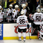 The Chicago Blackhawks head to the locker room after losing 2-0 to the Boston Bruins in Game 3 of the NHL hockey Stanley Cup Finals in Boston, Monday, June 17, 2013. (AP Photo/Charles Krupa)
