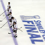 Chicago Blackhawks players stand during the national anthem before Game 3 of the NHL hockey Stanley Cup Finals against the Boston Bruins in Boston, Monday, June 17, 2013. (AP Photo/Charles K …