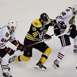 Boston Bruins center Tyler Seguin (19) pursues the puck between Chicago Blackhawks left wing Bryan Bickell (29) and Blackhawks defenseman Michal Rozsival (32), of the Czech Republic, during  …