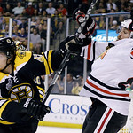 Boston Bruins defenseman Torey Krug (47) shoves Chicago Blackhawks left wing Viktor Stalberg, right, of Sweden,during the first period in Game 3 of the NHL hockey Stanley Cup Finals in Bosto …