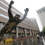 A statue of Boston Bruins legend Bobby Orr soars outside TD Garden before Game 3 of the NHL hockey Stanley Cup Finals between the Boston Bruins and the Chicago Blackhawks in Boston, Monday,  …