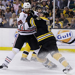 Boston Bruins defenseman Johnny Boychuk (55) stands up against Chicago Blackhawks center Michal Handzus (26), of Slovakia, and during the first period in Game 3 of the NHL hockey Stanley Cup …