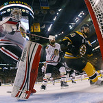 Chicago Blackhawks goalie Corey Crawford, left, and defenseman Brent Seabrook (7) defend against Boston Bruins left wing Kaspars Daugavins (16), of Latavia, during the third period in Game 3 …