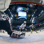 Chicago Blackhawks goalie Corey Crawford (50) turns the puck aside as Blackhawks defenseman Brent Seabrook (7) retrieves it during the first period in Game 3 of the NHL hockey Stanley Cup Fi …