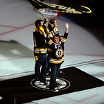 Rob Rogers, Jenn Rogers, and Jennifer Lemmerman, wave a Boston Strong banner before Game 3 of the NHL hockey Stanley Cup Finals between the Boston Bruins and the Chicago Blackhawks in Boston …