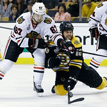 Chicago Blackhawks center Michael Frolik (67), of the Czech Republic, and Boston Bruins right wing Nathan Horton (18) scrap for the puck during the second period in Game 3 of the NHL hockey  …