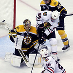 Boston Bruins goalie Tuukka Rask (40), of Finland, defends against Chicago Blackhawks center Michal Handzus (26), of Slovakia, as Bruins defenseman Dennis Seidenberg (44), of Germany, and Bl …