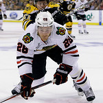 Boston Bruins defenseman Torey Krug (47) checks Chicago Blackhawks right wing Ben Smith (28) to the ice during the first period in Game 3 of the NHL hockey Stanley Cup Finals in Boston, Mond …